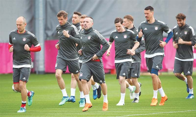 MUNICH Bayern Munich players attend a training session at the Saebener Strasse ground on Tuesday ahead of their UEFA Champions League quarter-final second leg against Sevilla.—Reuters