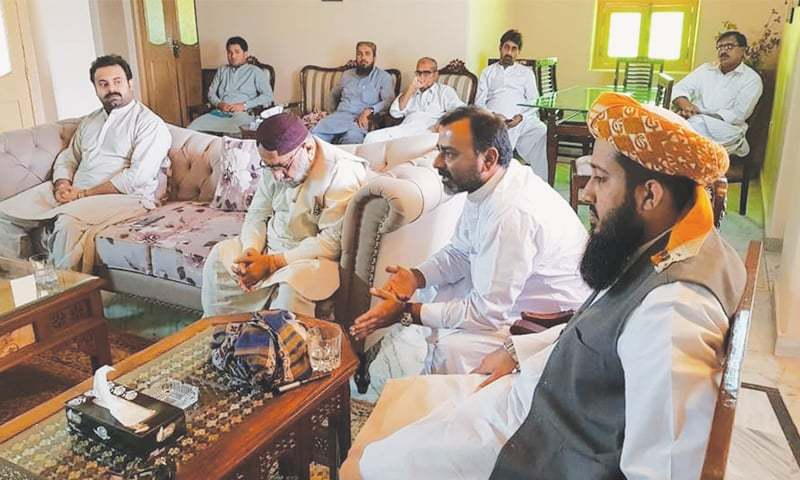 LARKANA Awami Ittehad's top brass discusses a strategy to counter PPP in the 2018 general election at a meeting in Kot Waleed on Tuesday.—Dawn