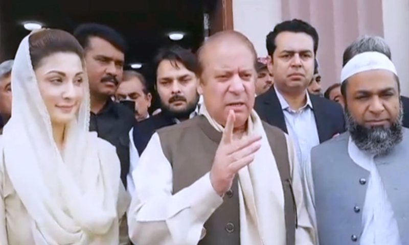 Former PM Nawaz Sharif speaks to reporters alongside his daughter Maryam Nawaz outside the accountability court. — DawnNewsTV