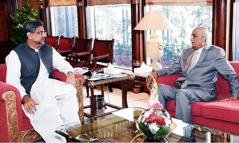 Prime Minister Shahid Khaqan Abbasi meets Leader of Opposition in National Assembly Syed Khursheed Shah. —APP