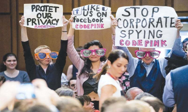 "MEMBERS of the audience hold up signs that read ""Stop Spying"" before Facebook CEO Mark Zuckerberg testifies before a US house committee on Capitol Hill, Washington.—AP"