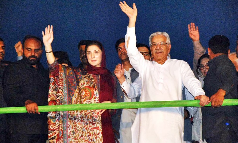 Maryam Nawaz and Foreign Minister Khawaja Asif respond to crowd during a political gathering in Sialkot. —APP