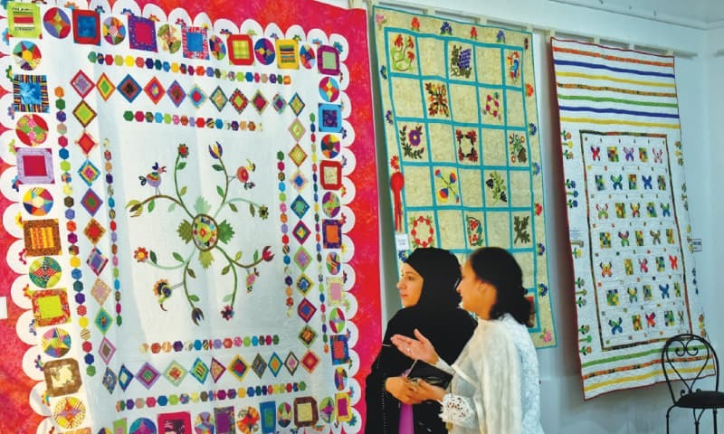 VISITORS view a variety of quilts at the exhibition on Friday.—Fahim Siddiqi/White Star