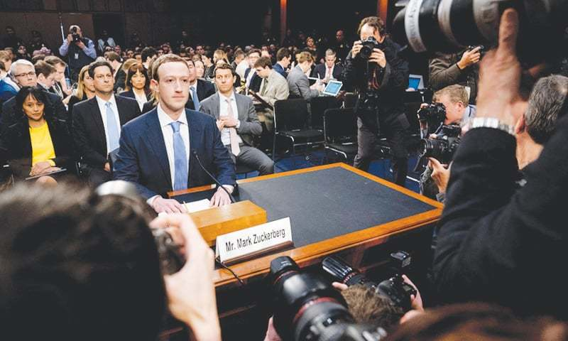 FACEBOOK CEO Mark Zuckerberg before his first congressional hearing on Tuesday.—AP