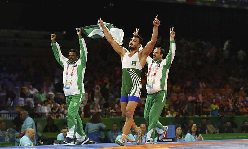 Pakistan's Muhammad Inam takes a victory lap with his coaches — AP