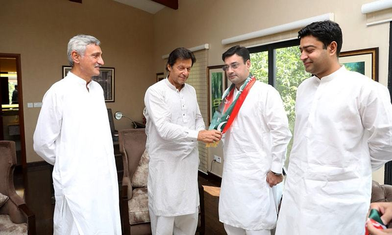 PTI chief Imran Khan welcoming Chaudhry Bilal Ahmed Virk into the fold at Bani Gala, Islamabad. —Photo by author