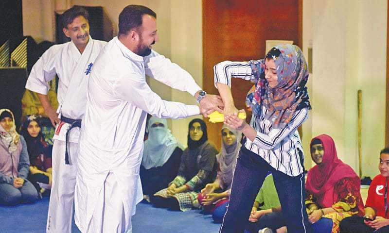 A WOMAN shows how to neutralise a potential armed attacker at the workshop on Friday.—White Star