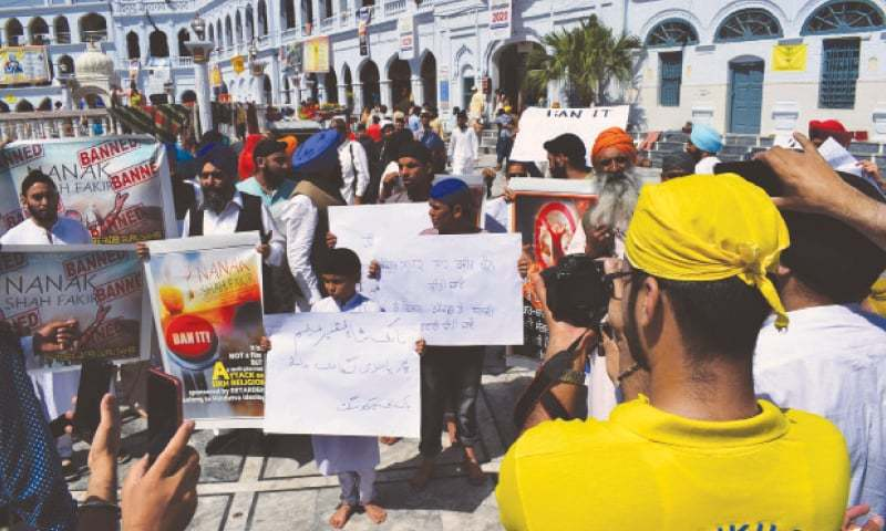 HASSANABDAL: Sikh pilgrims protest against the release of a controversial film in India.—Dawn