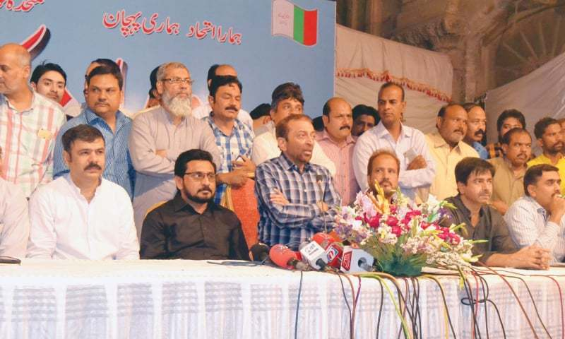 DR Farooq Sattar, along with other party colleagues, speaks at the press conference in Hyderabad on Monday.—Dawn