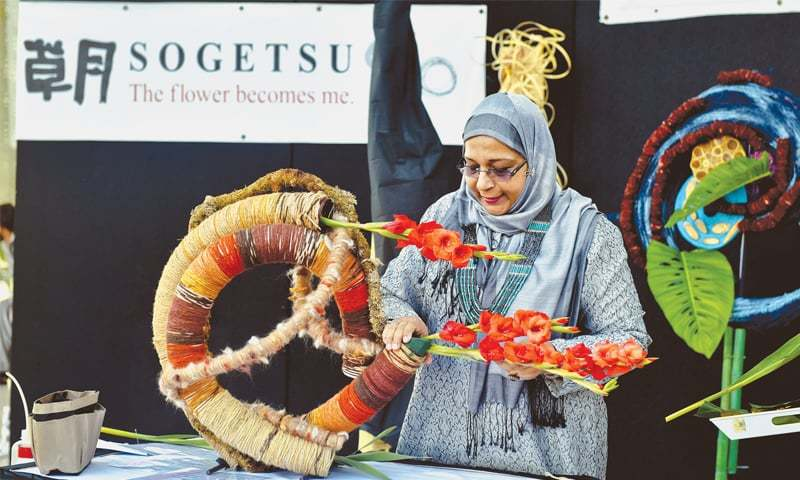 SALMA Ansari gives a practical demonstration of sogetsu flower arrangement on Thursday.—Fahim Siddiqi/White Star