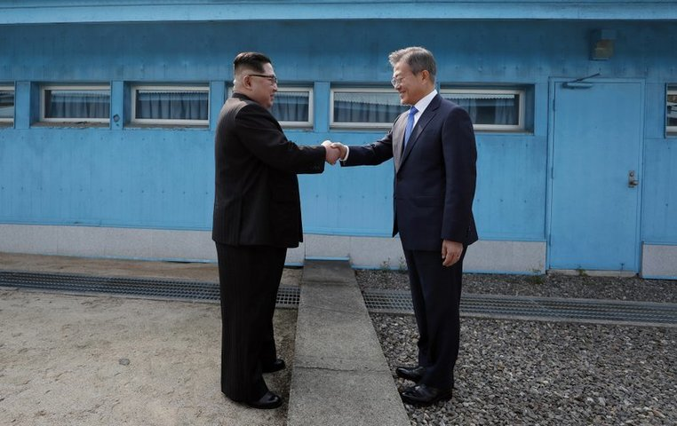 North Korean leader Kim Jong Un, left, shakes hands with South Korean President Moon Jae-in at the border village of Panmunjom in Demilitarized Zone on Friday. — AP