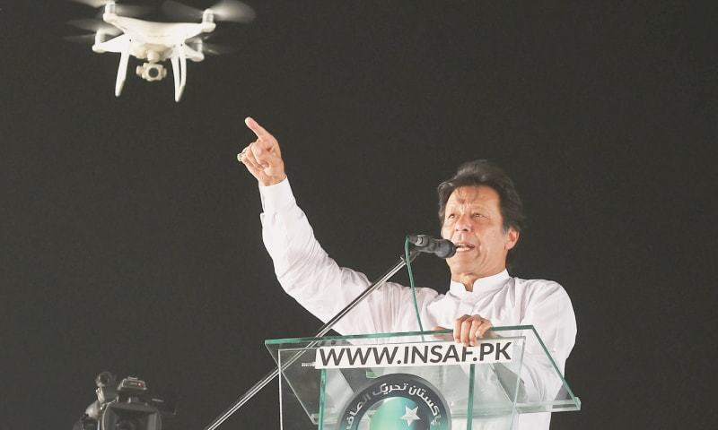LAHORE: Pakistan Tehreek-i-Insaf chairman Imran Khan speaks at the rally at Minar-i-Pakistan on Sunday.—Arif Ali / White Star