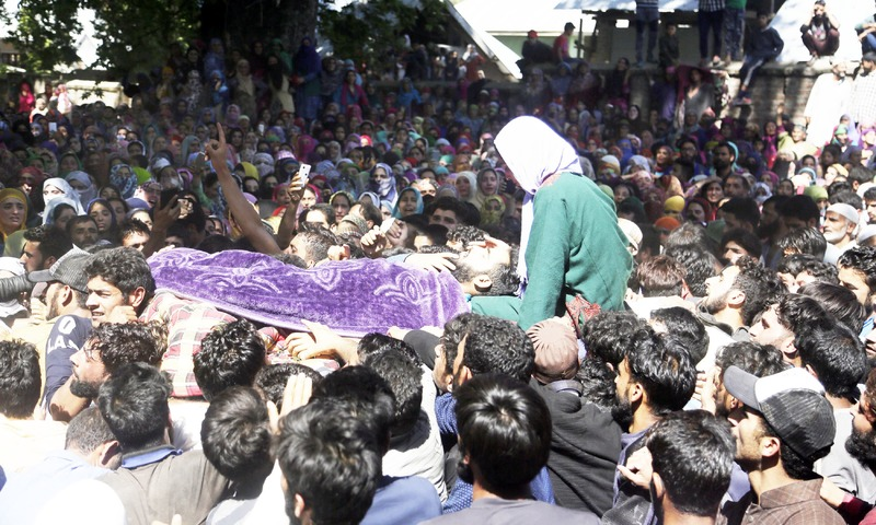 Villagers attend the funeral of Shahid Ahmad who was killed due to firing at protest by Indian troops. —AP
