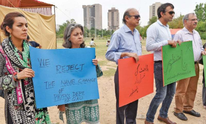Quaid-i-Azam University faculty members protest outside the National Press Club on Wednesday. — White Star
