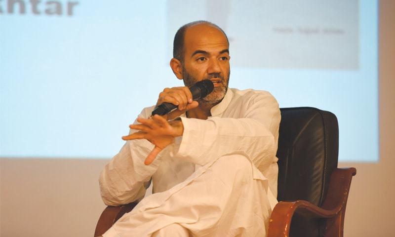 DR Asim Sajjad Akhtar speaks at the book launch on Friday.—Tahir Jamal/White Star
