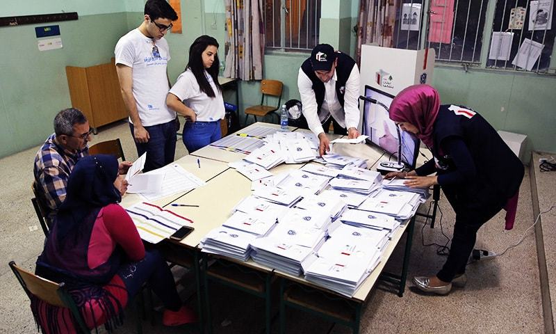 Election officials count ballots shortly after the polling stations closed in Beirut Lebanon.—AP