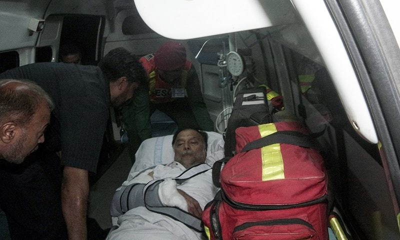 In this handout photograph, injured Interior Minister Ahsan Iqbal is being taken off from a helicopter on his arrival in Lahore. — AFP/PID