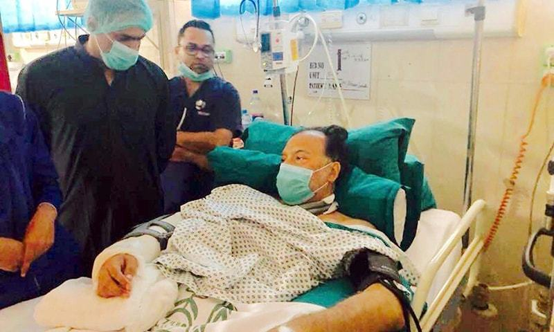 LAHORE: Minister of State for Water and Power Abid Sher Ali inquires about the health of Interior Minister Ahsan Iqbal at the Services Hospital on Monday.—INP