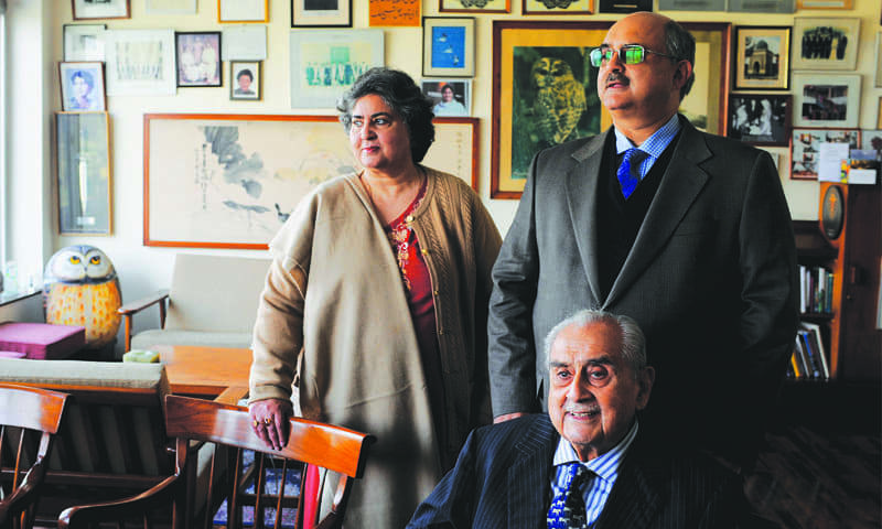 Syed Babar Ali is seated in his office at the Packages headquarters in Lahore. Standing behind him are his son Syed Haider Ali and his daughter Henna Babar Ali. Syed Babar Ali is one of Pakistan's most respected entrepreneurs and industrialists. He is the founder of Packages Limited, Pakistan's largest paper and board mill. Syed Babar Ali also set up Tetra Pak, Milkpak and Nestlé in Pakistan as joint ventures with multinationals. Given the increasing demand for organised retail in Lahore, his latest venture was the launch of Packages Mall in 2017. (photo: Arif Mahmood/ Dawn White Star)