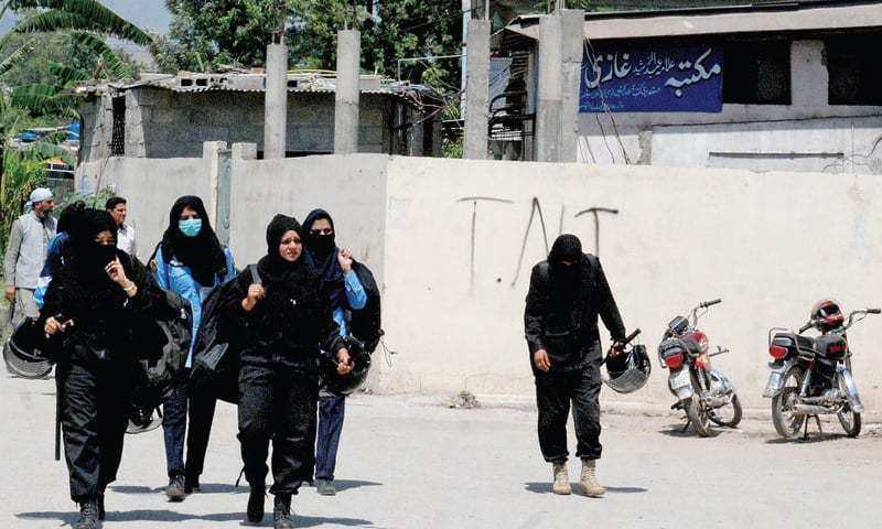 A contingent of women police on duty outside the Lal Masjid-affiliated madressah in G-6 on Friday. — White Star