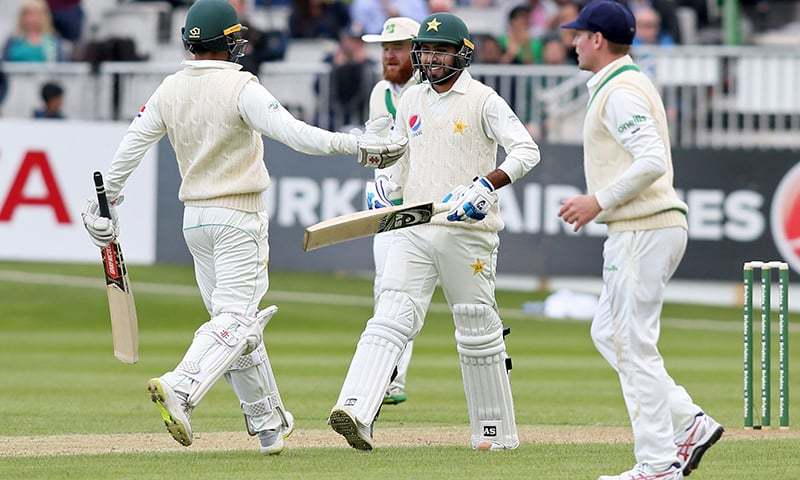 Pakistan's Faheem Ashraf celebrates with Pakistan's Shadab Khan (L) after reaching his half century during play on day two of Ireland's inaugural test match against Pakistan at Malahide cricket club, in Dublin on May 12, 2018. —AFP