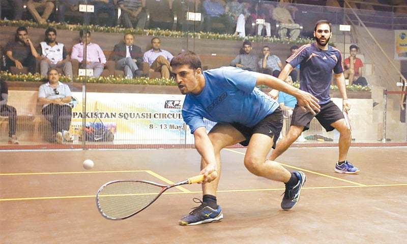 ISLAMABAD: Farhan Zaman plays a shot against Farhan Mehboob during their semi-final of the Pakistan Squash Circuit-I at the Mushaf Squash Complex on Saturday.