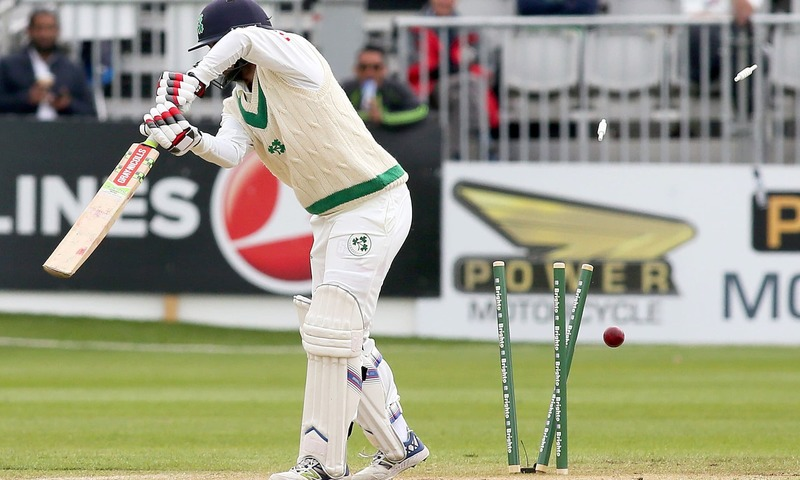 Bails fly as Ireland's Tyrone Kane loses his wicket for 14 runs, ending Irelands 2nd innings at 339 all out, on the final day of Ireland's inaugural test match against Pakistan at Malahide cricket club, in Dublin on May 15, 2018. — AFP