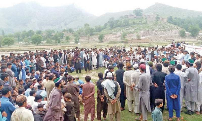 People attend an election campaign related gathering at a picturesque location of Tirah valley. — Dawn
