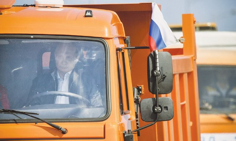 Kerch (Crimea): Russian President Vladimir Putin drives a truck during the opening ceremony of a much-anticipated bridge linking Russia and the Crimean peninsula—AP
