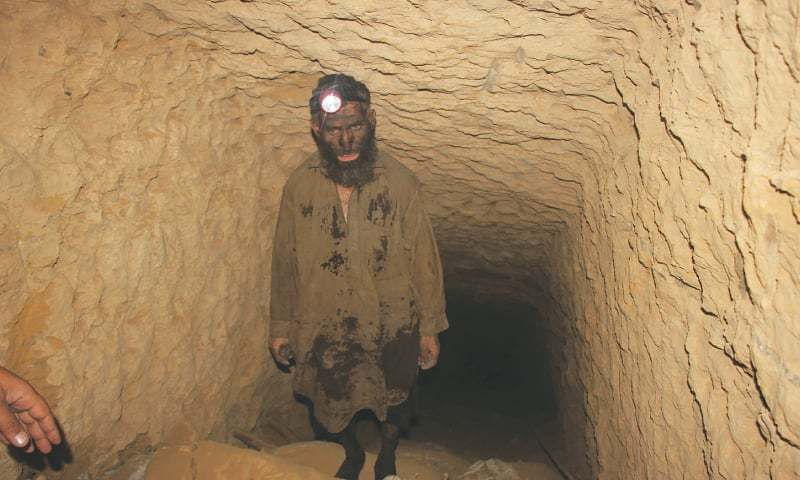 A worker comes out of a coal mine in Lakhra.—Photo by writer