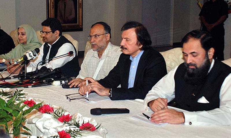 Interior Minister Ahsan Iqbal along with other ministers addressing a press conference at Punjab House. — APP