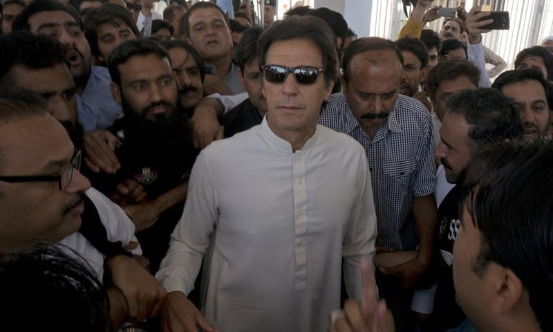 ISLAMABAD: Pakistan Tehreek-i-Insaf chairman Imran Khan leaves Parliament House after attending the National Assembly session on Thursday.—Tanveer Shahzad / White Star