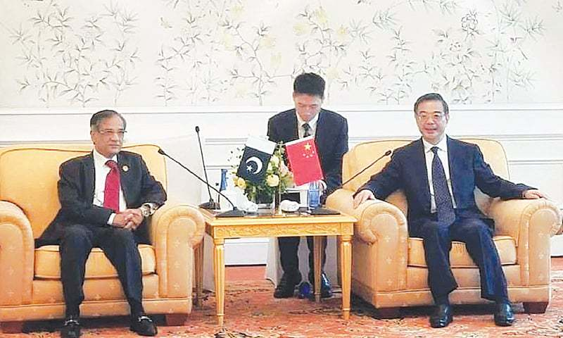 BEIJING: Chief Justice of Pakistan Mian Saqib Nisar and the President of the Supreme People's Court of China Zhou Qiang during a meeting on Thursday.—APP