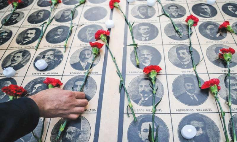 PEOPLE lay red carnations on pictures of the intellectuals seized on April 24, 1915 and murdered during the first wave of killings of the Armenian genocide at a memorial event in Istanbul in this file picture.