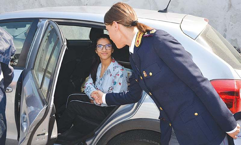 THE photo carried by a local newspaper shows Farah leave the police station in Verona after having given a statement.