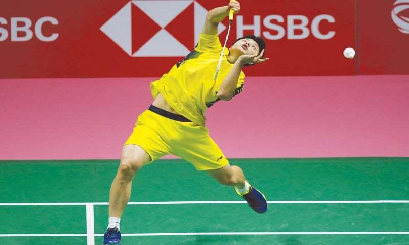 BANGKOK: Shi Yuqi of China hits a return to Kenta Nishimoto of Japan during their Thomas Cup final on Sunday.—AP