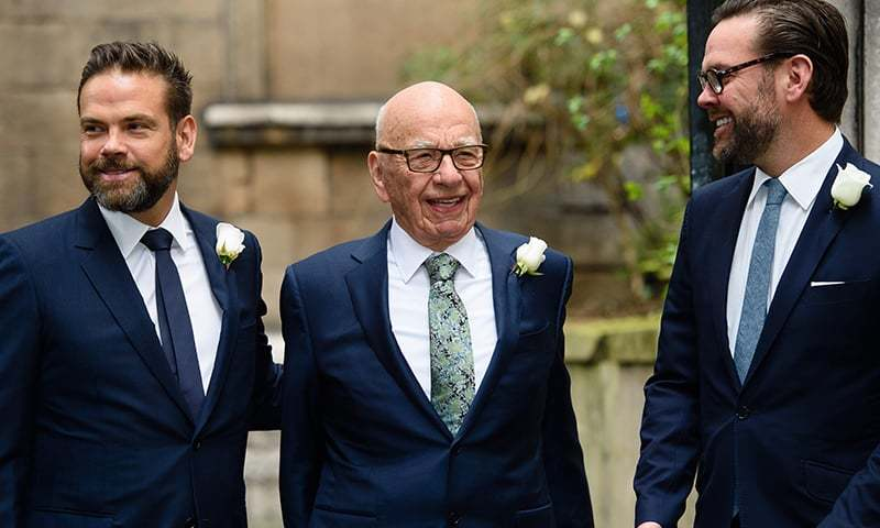 In this file photo Australian born media magnate Rupert Murdoch (C) flanked by his sons Lachlan (L) and James (R) at St Bride's church on Fleet Street in central London to attend a ceremony of celebration a day after the official marriage of Rupert Murdoch and former US model Jerry Hall. — AFP