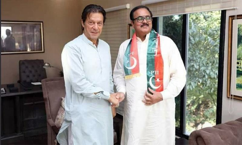 A photo of PTI Chairman Imran Khan with Farooq Bandial. — Photo: Twitter