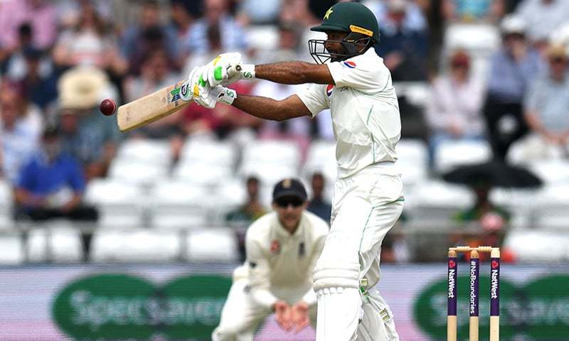 Asad Shafiq hits a shot for four runs on the first day of the second Test. —AFP