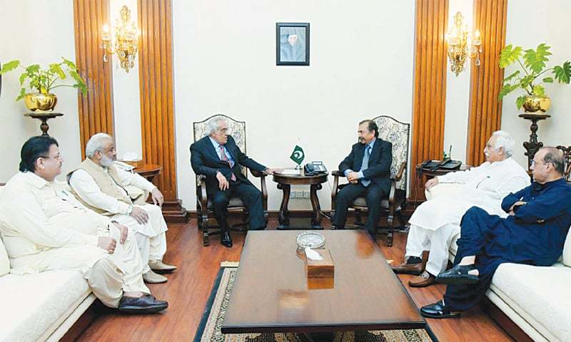 Caretaker Chief Minister Fazal-ur-Rahman exchanges views with the Grand Democratic Alliance delegation at  CM House on Tuesday.—PPI