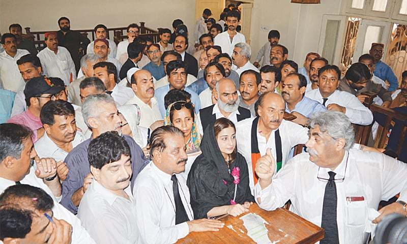 SINDH PPP president Nisar Khuhro and his daughter Nida Khuhro file their nomination papers on Thursday.—Dawn