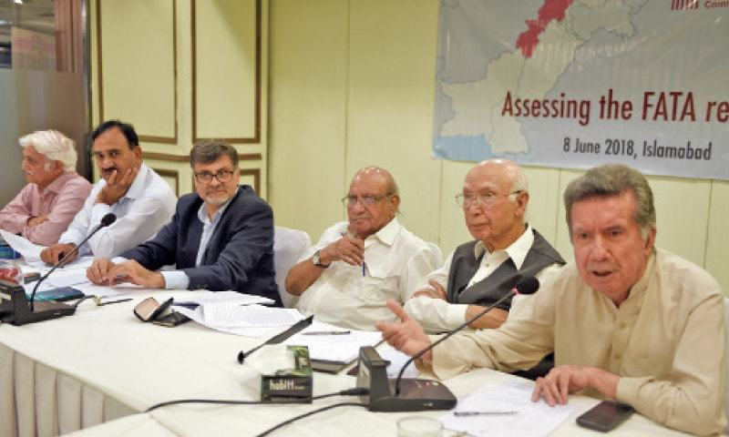 Afrasiab Khattak speaks at the seminar on Friday. Sartaj Aziz, HRCP's I.A. Rehman and Kamran Arif, Sher M. Khan and Farhatullah Babar are also seen. — White Star