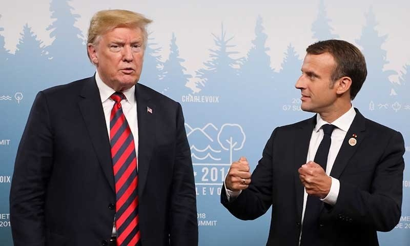 US President Donald Trump and French President Emmanuel Macron hold a meeting on the sidelines of the G7 Summit — AFP