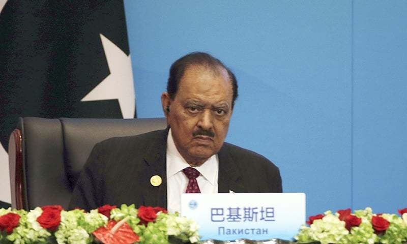 President Mamnoon Hussain looks on during the signing ceremony for the Shanghai Cooperation Organization (SCO) Summit in Qingdao. ─ AP