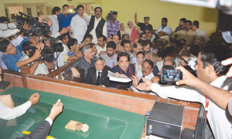 Bilawal Bhutto-Zardari and Maulana Rashid Soomro file their nomination papers for NA-200 Larkana on Monday.—Dawn