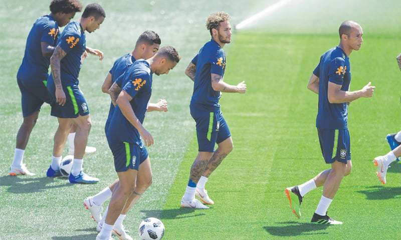 SOCHI: Neymar (C) jogs with his Brazilian team-mates during a training session on Tuesday.—AP
