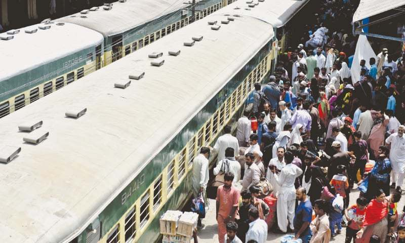 PEOPLE wait at the platform at Cantonment station to board the Eid train on Tuesday.—White Star