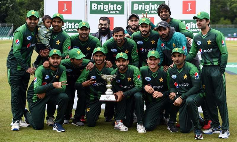 The Pakistan team pose for a photograph with the trohy after winning both of their Twenty20 International matches against Scotland, on the second day at the Grange Cricket Club in Edinburgh, Scotland on Wednesday. — AFP