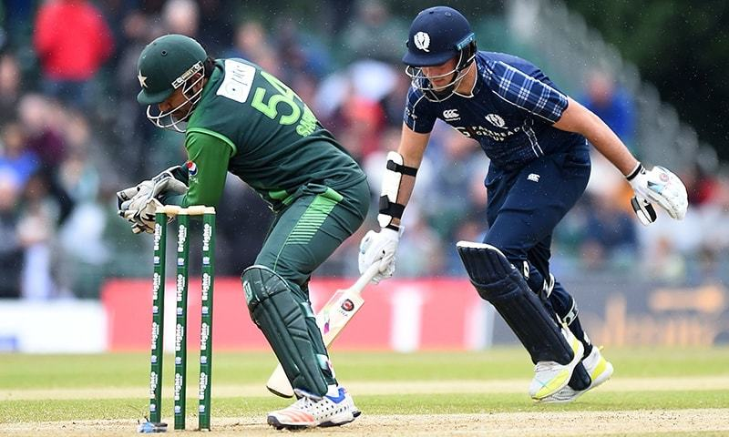 Pakistan's Sarfraz Ahmed (L) takes wicket of Scotland's Mark Watt during the second Twenty20 International cricket match between Scotland and Pakistan. — AFP