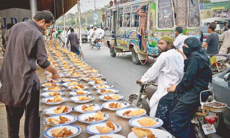 IN Karachi, conscientious citizens ensure no one is left out at Iftar time.—Fahim Siddiqi/White Star